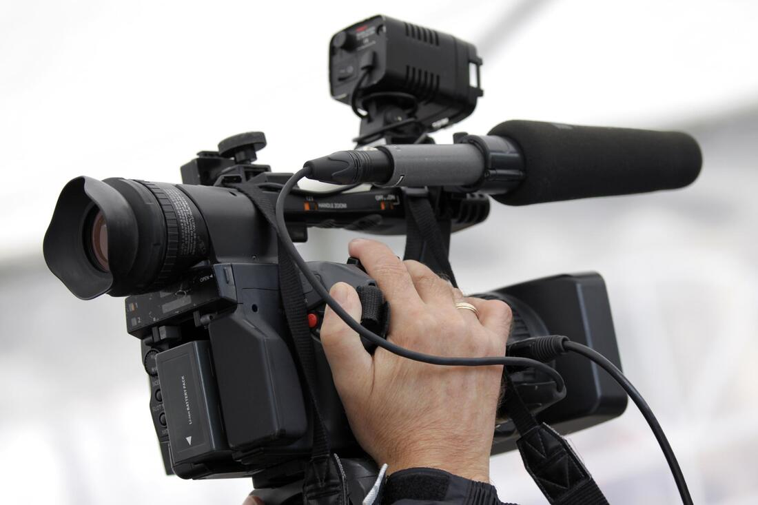 man holding a black camera